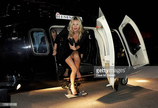 Kate Moss arrives via helicopter to the Rimmel Kate Moss Party to celebrate their 10 year partnership at Battersea Power station on September 15 2011...