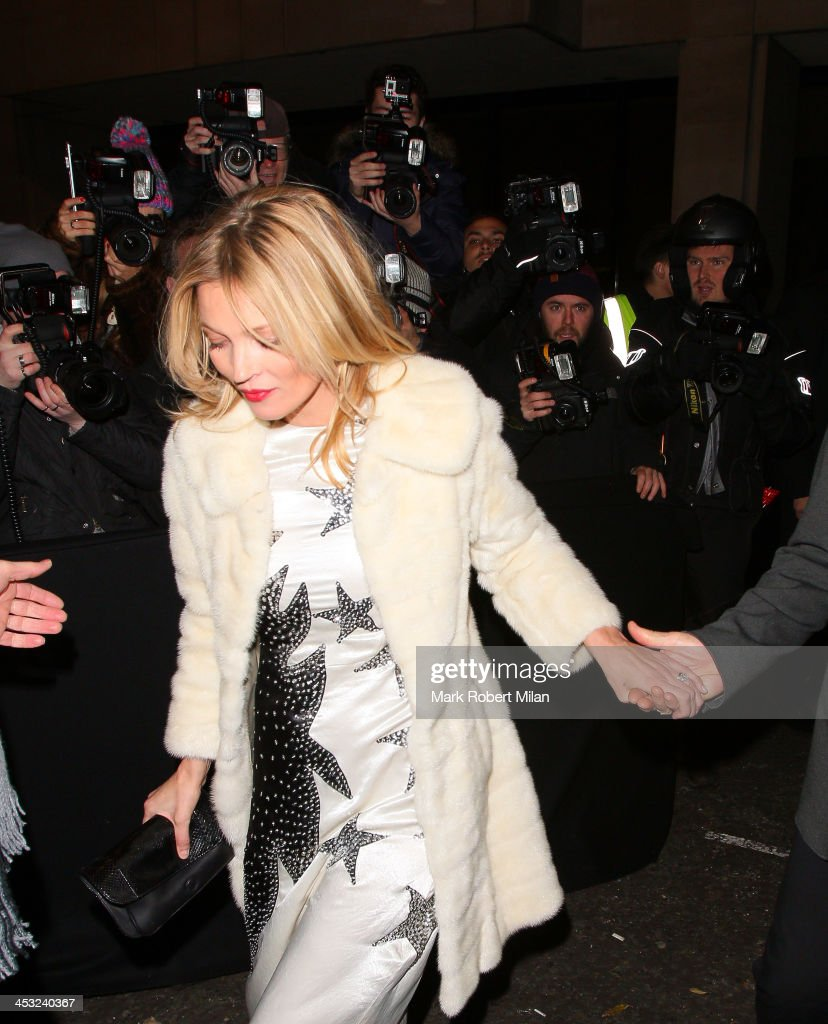 <a gi-track='captionPersonalityLinkClicked' href=/galleries/search?phrase=Kate+Moss&family=editorial&specificpeople=201830 ng-click='$event.stopPropagation()'>Kate Moss</a> at the Playboy club on December 2, 2013 in London, England.