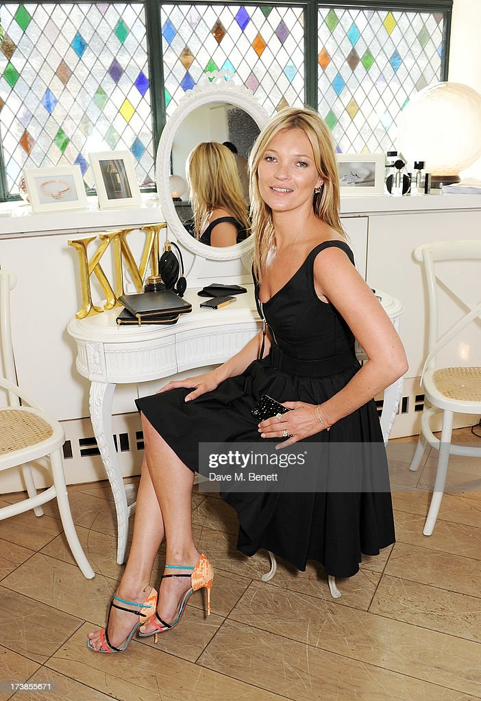 <a gi-track='captionPersonalityLinkClicked' href=/galleries/search?phrase=Kate+Moss&family=editorial&specificpeople=201830 ng-click='$event.stopPropagation()'>Kate Moss</a> attends a first look at a new range of tech accessories for Carphone Warehouse, designed exclusively by <a gi-track='captionPersonalityLinkClicked' href=/galleries/search?phrase=Kate+Moss&family=editorial&specificpeople=201830 ng-click='$event.stopPropagation()'>Kate Moss</a> for the high street brand, at The Club at The Ivy on July 18, 2013 in London England. The range of smartphone and tablet accessories goes on sale nationwide later this month.