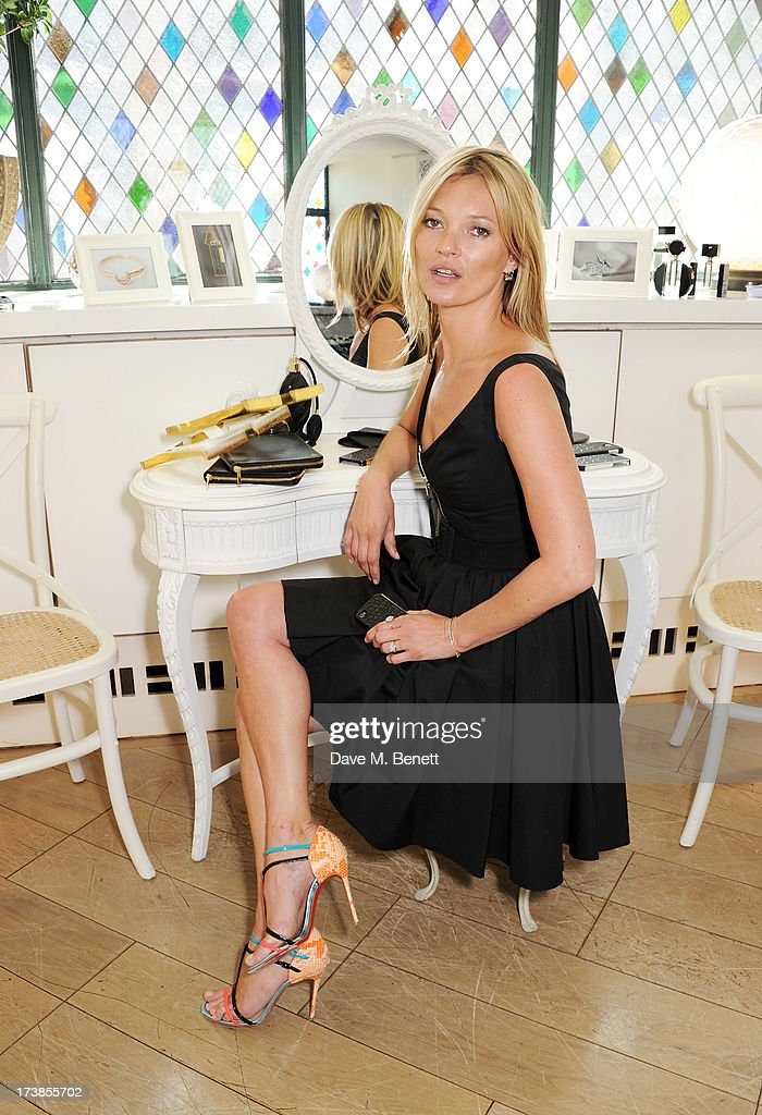 Kate Moss attends a first look at a new range of tech accessories for Carphone Warehouse, designed exclusively by Kate Moss for the high street brand, at The Club at The Ivy on July 18, 2013 in London England. The range of smartphone and tablet accessories goes on sale nationwide later this month.