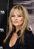 Kate Moss attends a photocall as she signs bottles of her new perfume 'Vintage Muse' at Boots on November 26 2010 in London England