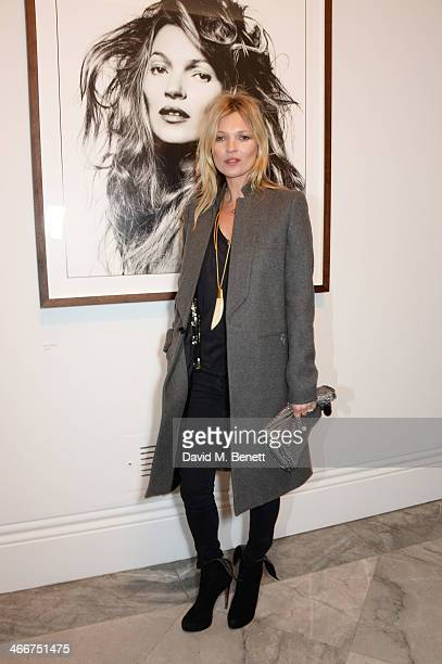 Kate Moss attends a private view of Bailey's Stardust a exhibition of images by David Bailey supported by Hugo Boss at the National Portrait Gallery...