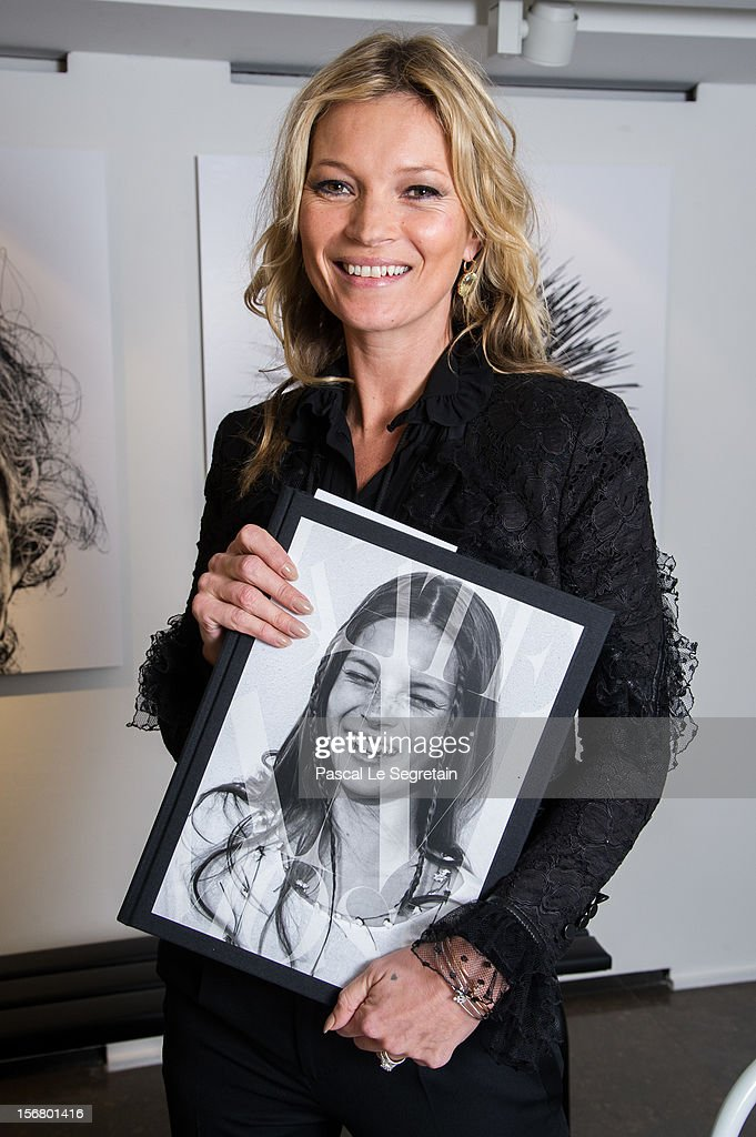 Kate Moss attends a signing session for the book 'Kate: The Kate Moss Book' at Colette on November 21, 2012 in Paris, France.