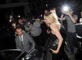 Kate Moss attends Mario Testino's exhibition 'Kate Who' at Phillips De Pury on July 5 2010 in London England