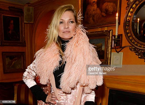 Kate Moss attends the launch of Annabel's DocuFilm 'A String of Naked Lightbulbs' at Annabel's on October 28 2014 in London England