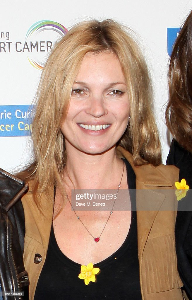 <a gi-track='captionPersonalityLinkClicked' href=/galleries/search?phrase=Kate+Moss&family=editorial&specificpeople=201830 ng-click='$event.stopPropagation()'>Kate Moss</a> attends the launch of Samsung's NX Smart Camera at a charity auction with David Bailey in aid of Marie Curie Cancer Care at the Bulgari Hotel on May 14, 2013 in London, England.