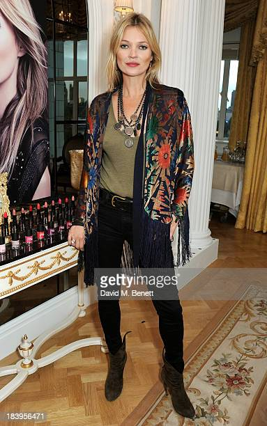 Kate Moss attends the Rimmel London 180 Years Of Cool photocall at The Savoy Hotel on October 10 2013 in London England