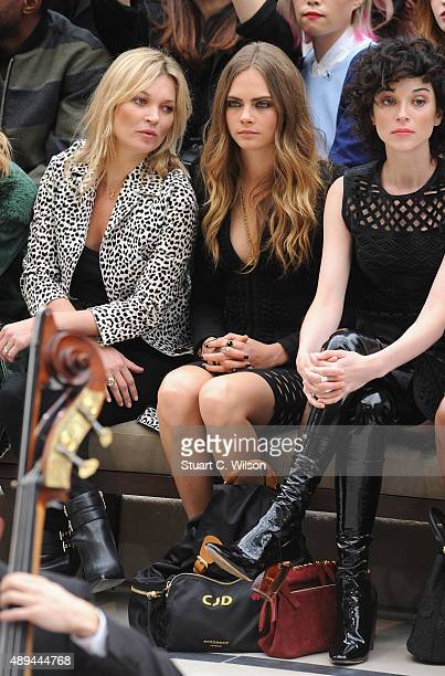 Kate Moss Cara Delevingne and Annie Clark attend the Burberry Womenswear Spring/Summer 2016 show during London Fashion Week at Kensington Gardens on...