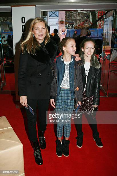 Kate Moss daughter Lila Grace Moss and guest attend the World Premiere of 'Paddington' at Odeon Leicester Square on November 23 2014 in London England