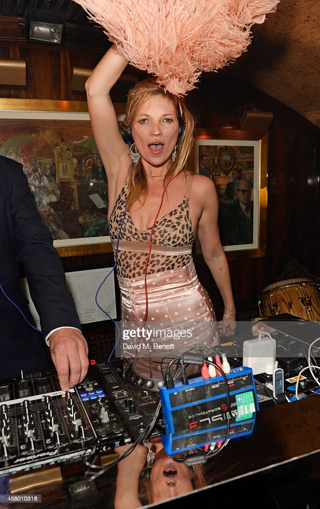 <a gi-track='captionPersonalityLinkClicked' href=/galleries/search?phrase=Kate+Moss&family=editorial&specificpeople=201830 ng-click='$event.stopPropagation()'>Kate Moss</a> DJ's at the launch of Annabel's Docu-Film 'A String of Naked Lightbulbs' at Annabel's on October 28, 2014 in London, England.