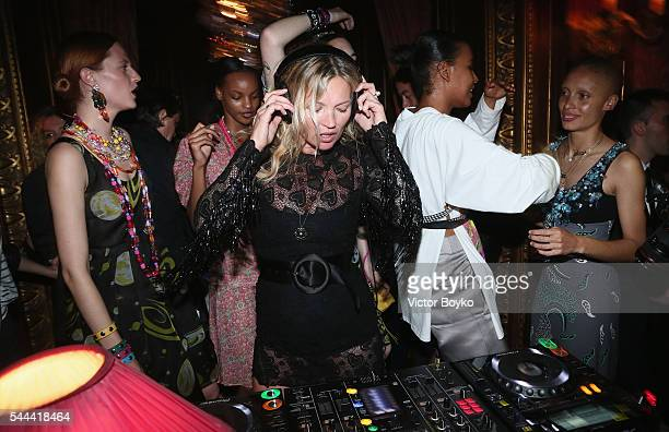 Kate Moss DJs during The Miu Miu Club And Croisiere 2017 Collection Presentation at Hotel De La Paiva on July 3 2016 in Paris France