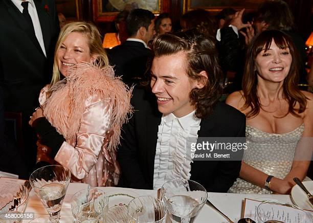 Kate Moss Harry Styles and Annabelle Neilson attend the launch of Annabel's DocuFilm 'A String of Naked Lightbulbs' at Annabel's on October 28 2014...