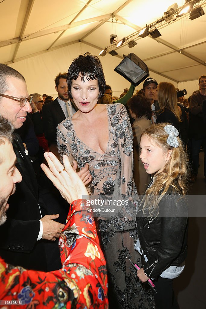 <a gi-track='captionPersonalityLinkClicked' href=/galleries/search?phrase=Kate+Moss&family=editorial&specificpeople=201830 ng-click='$event.stopPropagation()'>Kate Moss</a> (C), her daughter Lila Grace (R) and Marc Jacobs (L) share a light moment backstage following the Louis Vuitton Fall/Winter 2013 Ready-to-Wear show as part of Paris Fashion Week on March 6, 2013 in Paris, France.