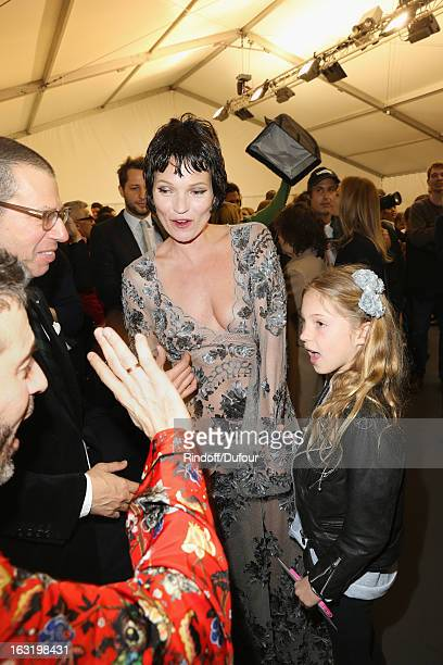 Kate Moss her daughter Lila Grace and Marc Jacobs share a light moment backstage following the Louis Vuitton Fall/Winter 2013 ReadytoWear show as...