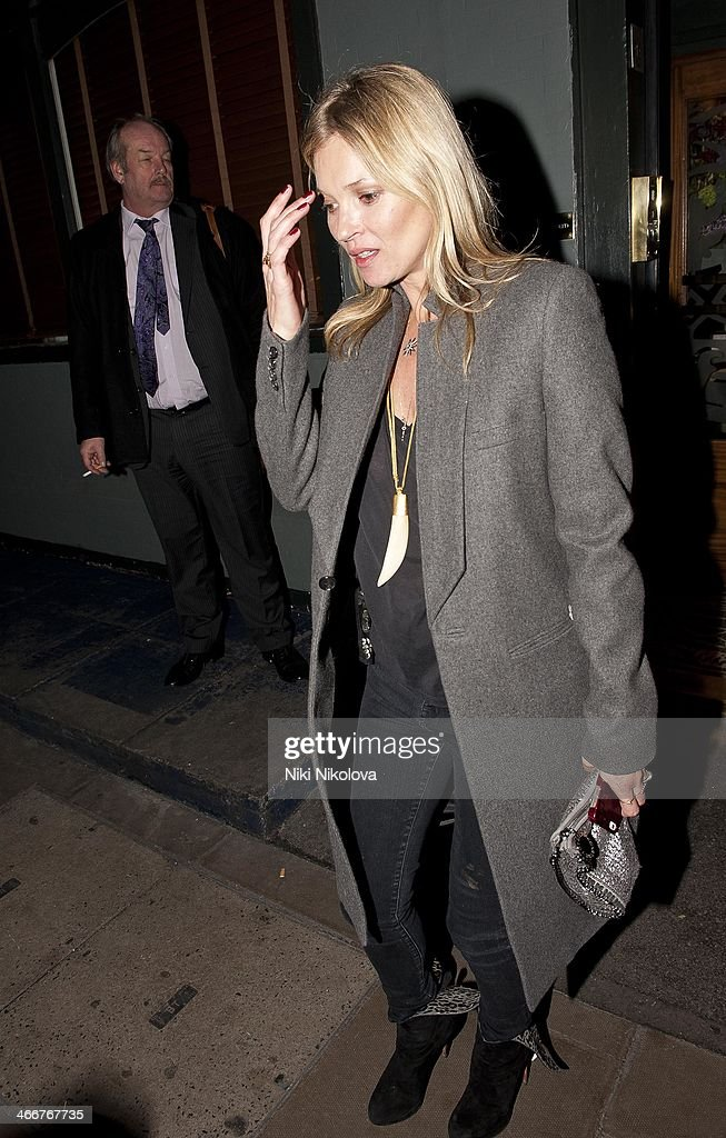 <a gi-track='captionPersonalityLinkClicked' href=/galleries/search?phrase=Kate+Moss&family=editorial&specificpeople=201830 ng-click='$event.stopPropagation()'>Kate Moss</a> is seen leaving the Groucho Club, Soho on February 3, 2014 in London, England.