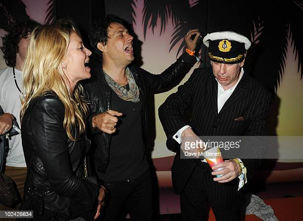 Kate Moss Jamie Hince and Mick Jones attends the PlayStation 3 SingStar backstage karaoke party at Glastonbury Festival 2010 on June 25 2010 in...