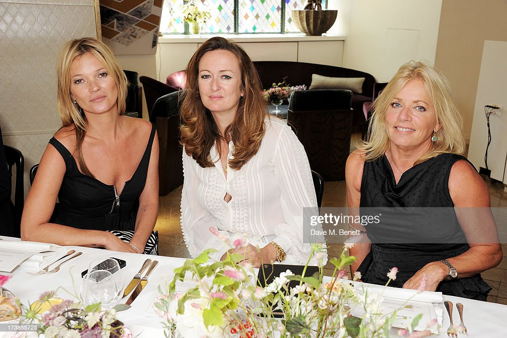 (L to R) Kate Moss, Lucy Yeomans and Sarah Doukas attend a first look at a new range of tech accessories for Carphone Warehouse, designed exclusively by Kate Moss for the high street brand, at The Club at The Ivy on July 18, 2013 in London England. The range of smartphone and tablet accessories goes on sale nationwide later this month.