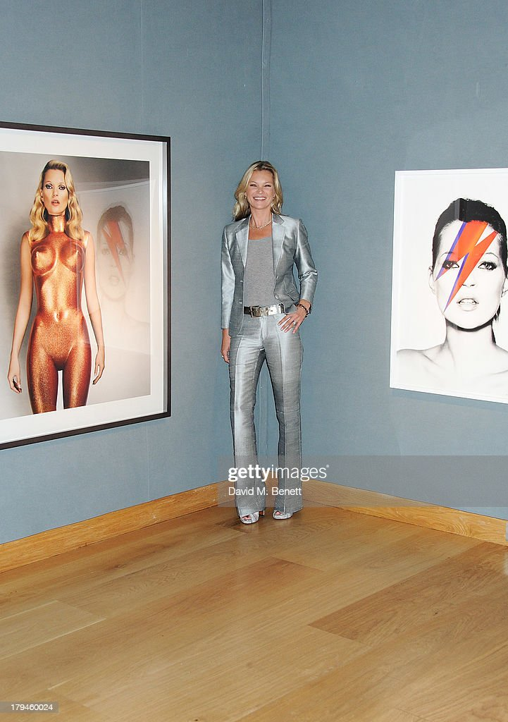 <a gi-track='captionPersonalityLinkClicked' href=/galleries/search?phrase=Kate+Moss&family=editorial&specificpeople=201830 ng-click='$event.stopPropagation()'>Kate Moss</a> poses at a photocall ahead of the '<a gi-track='captionPersonalityLinkClicked' href=/galleries/search?phrase=Kate+Moss&family=editorial&specificpeople=201830 ng-click='$event.stopPropagation()'>Kate Moss</a>: The Collection' auction which sees various artworks of the model, curated by Gert Elfering, go under the hammer at Christie's King Street on September 4, 2013 in London, England.