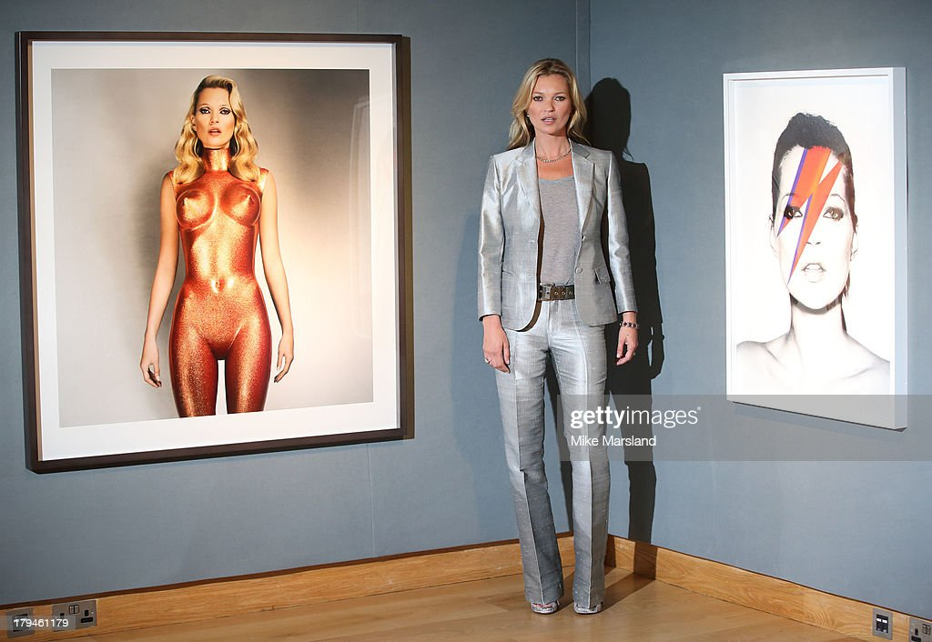 <a gi-track='captionPersonalityLinkClicked' href=/galleries/search?phrase=Kate+Moss&family=editorial&specificpeople=201830 ng-click='$event.stopPropagation()'>Kate Moss</a> poses at a photocall ahead of the '<a gi-track='captionPersonalityLinkClicked' href=/galleries/search?phrase=Kate+Moss&family=editorial&specificpeople=201830 ng-click='$event.stopPropagation()'>Kate Moss</a>: The Collection' auction which sees various artworks of the model curated by Gert Elfering go under the hammer at Christie's King Street on September 4, 2013 in London, England.