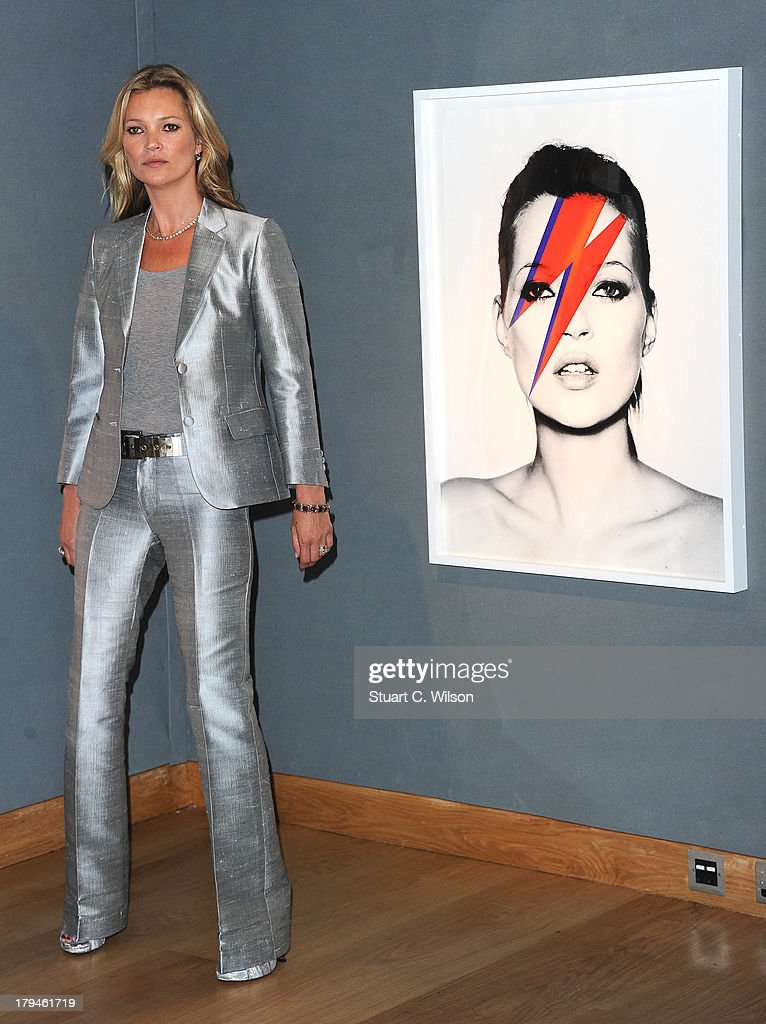Kate Moss poses at a photocall ahead of the 'Kate Moss The Collection' auction which sees various artworks of the model curated by Gert Elfering go...