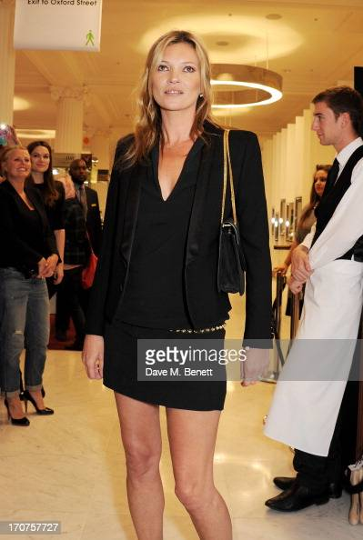 Kate Moss poses at a photocall to unveil a new portrait by artist Chris Levine during the launch of 'Charlotte Tilbury's MakeUp House Of Rock n'Kohl'...