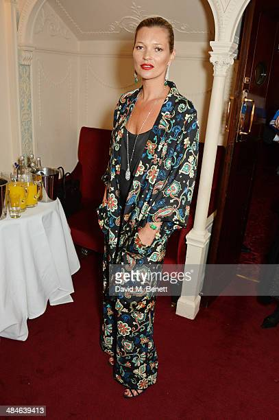 Kate Moss poses backstage at the Laurence Olivier Awards at The Royal Opera House on April 13 2014 in London England