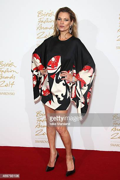 Kate Moss poses in the winners room at the British Fashion Awards at London Coliseum on December 1 2014 in London England