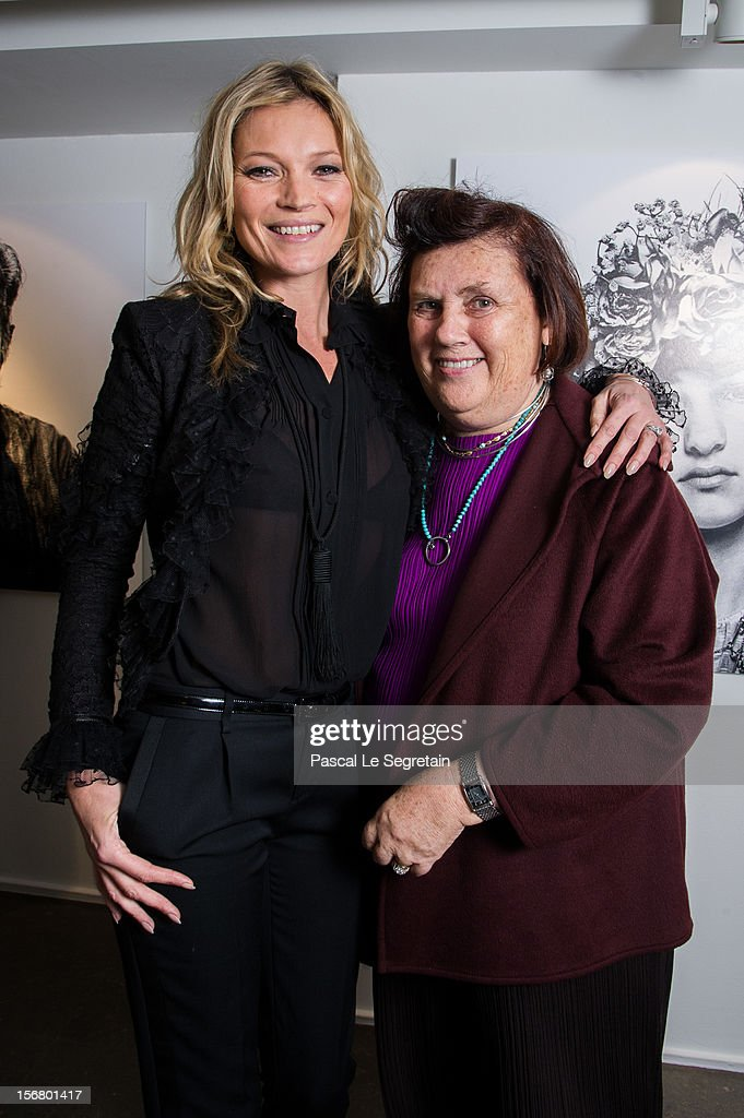 Kate Moss poses with Suzy Menkes as she attends a signing session for the book 'Kate: The Kate Moss Book' at Colette on November 21, 2012 in Paris, France.