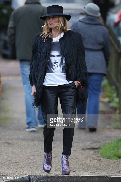 Kate Moss seen leaving her house with a friend both wearing David Bowie TShirts on January 11 2016 in London England