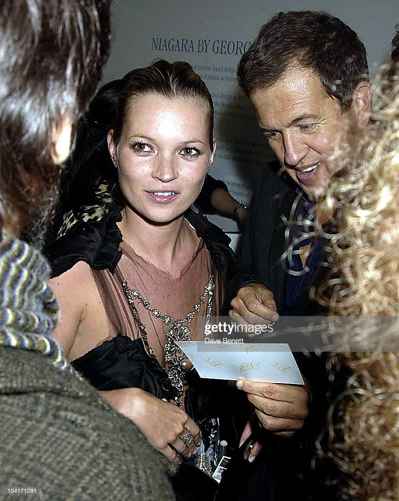 Kate Moss Shows Mario Testino A Picture Of Her Baby, Opening Of The Manolo Blahnik Exhibition At The Design Museum, London