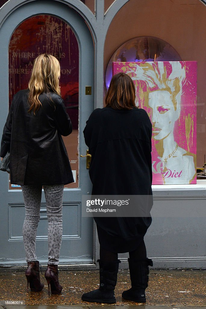 Kate Moss (L) sighted in Notting Hill enquiring about a piece of artwork in a shop window featuring herself on March 8, 2013 in London, England.