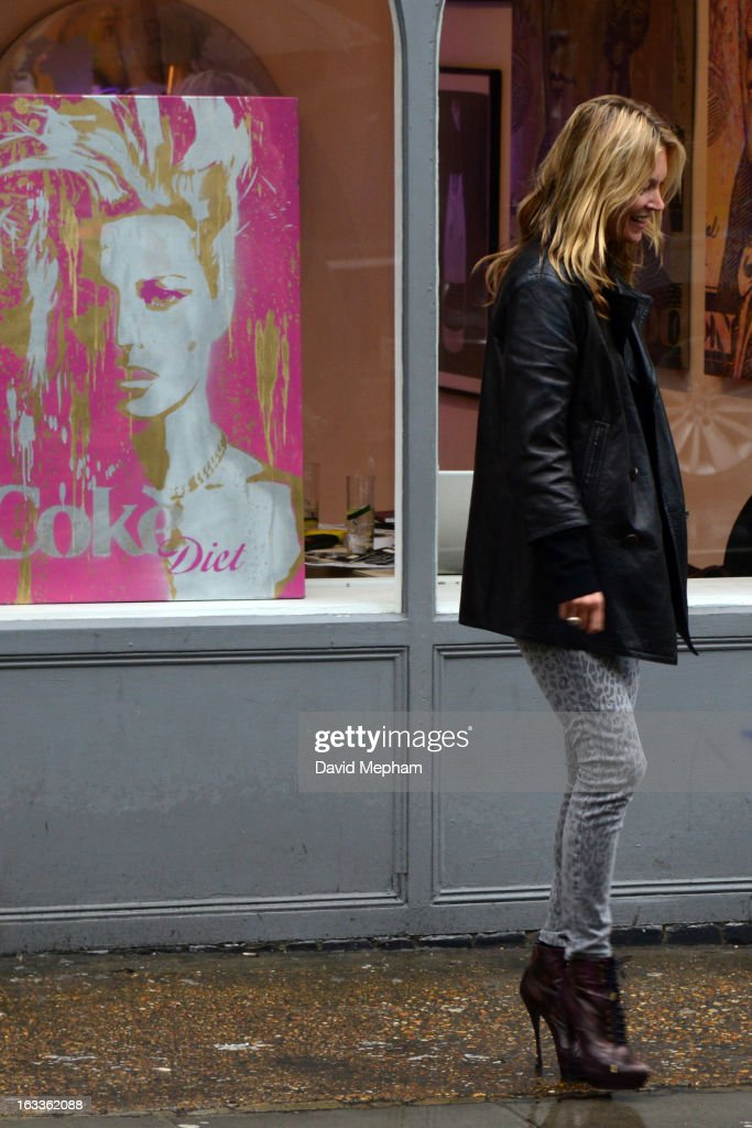 <a gi-track='captionPersonalityLinkClicked' href=/galleries/search?phrase=Kate+Moss&family=editorial&specificpeople=201830 ng-click='$event.stopPropagation()'>Kate Moss</a> sighted in Notting Hill enquiring about a piece of artwork displayed in a shop window featuring herself on March 8, 2013 in London, England.