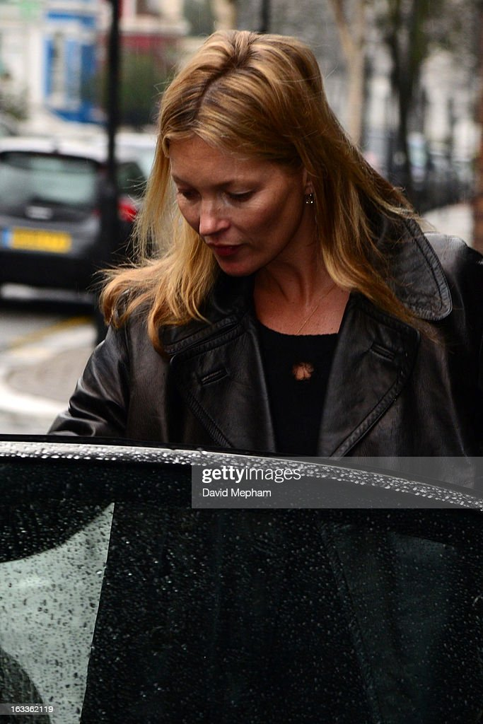 Kate Moss sighted in Notting Hill enquiring about a piece of artwork featuring herself displayed in a shop window on March 8, 2013 in London, England.