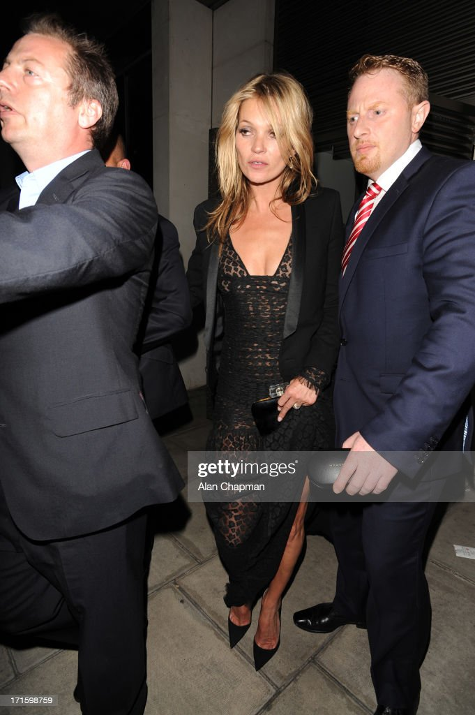 <a gi-track='captionPersonalityLinkClicked' href=/galleries/search?phrase=Kate+Moss&family=editorial&specificpeople=201830 ng-click='$event.stopPropagation()'>Kate Moss</a> sighting leaving 45 Park Lane on June 26, 2013 in London, England.