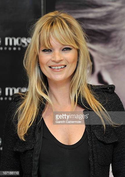 Kate Moss signs bottles of her new fragrance 'Vintage Muse' at Boots on November 26 2010 in London England