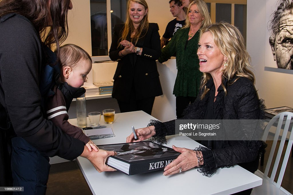 <a gi-track='captionPersonalityLinkClicked' href=/galleries/search?phrase=Kate+Moss&family=editorial&specificpeople=201830 ng-click='$event.stopPropagation()'>Kate Moss</a> signs her book 'Kate: The <a gi-track='captionPersonalityLinkClicked' href=/galleries/search?phrase=Kate+Moss&family=editorial&specificpeople=201830 ng-click='$event.stopPropagation()'>Kate Moss</a> Book' at Colette on November 21, 2012 in Paris, France.