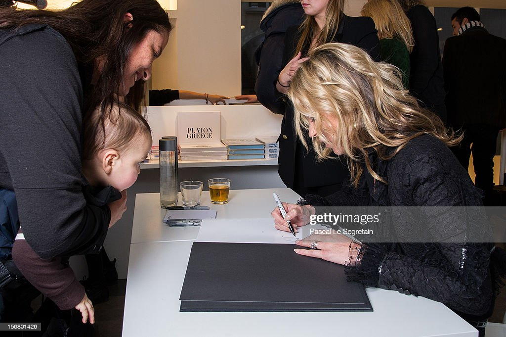 Kate Moss signs her book 'Kate: The Kate Moss Book' at Colette on November 21, 2012 in Paris, France.