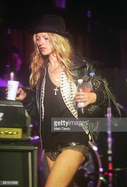 Kate Moss walks across the Leftfield Stage on her way to watch her boyfriend Pete Doherty and his band Babyshambles perform on the second day of the...