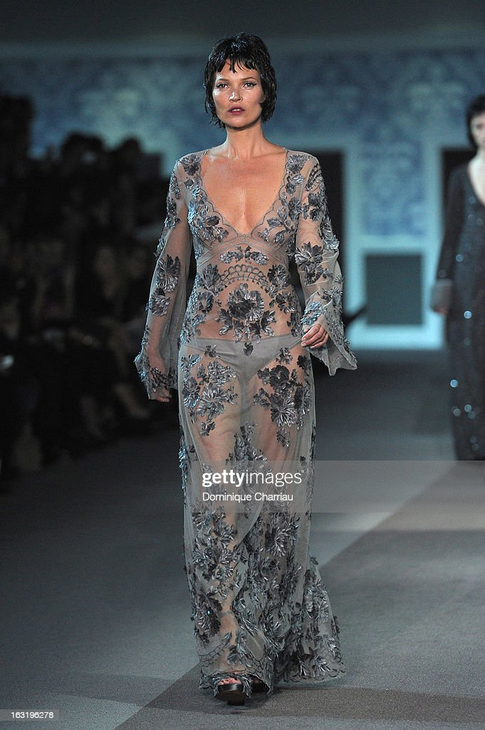 Kate Moss walks the runway during the Louis Vuitton Fall/Winter 2013 Ready-to-Wear show as part of Paris Fashion Week on March 6, 2013 in Paris, France.