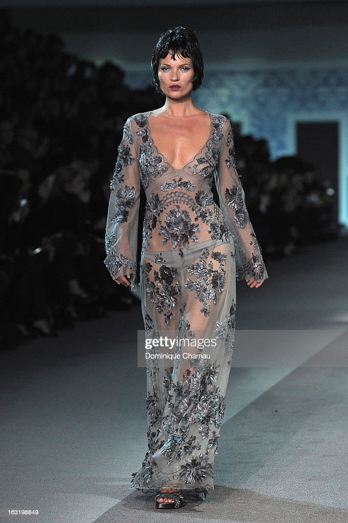 <a gi-track='captionPersonalityLinkClicked' href=/galleries/search?phrase=Kate+Moss&family=editorial&specificpeople=201830 ng-click='$event.stopPropagation()'>Kate Moss</a> walks the runway during the Louis Vuitton Fall/Winter 2013 Ready-to-Wear show as part of Paris Fashion Week on March 6, 2013 in Paris, France.