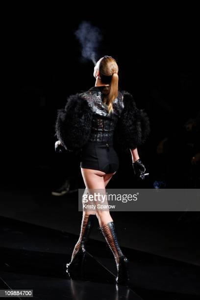 Kate Moss walks the runway during the Louis Vuitton Ready to Wear Autumn/Winter 2011/2012 show during Paris Fashion Week at Cour Carree du Louvre on...