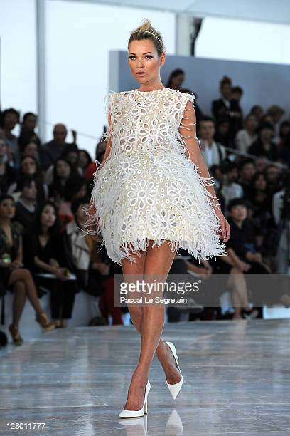 Kate Moss walks the runway during the Louis Vuitton Ready to Wear Spring / Summer 2012 show during Paris Fashion Week on October 5 2011 in Paris...