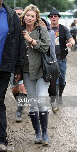 Kate Moss walks to see The Kills play on the John Peal Stage at the Glastonbury Festival on June 27 2008 in Glastonbury Somerset England The threeday...