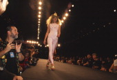 Kate Moss wearing a cowboy hat walks the runway in a fashion show by designer label Ghost in 1995 in New York City New York