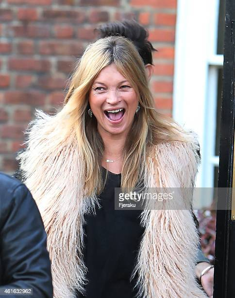 Kate Moss wears a bright smile and a long furry coat as she heads to the Cotswolds with husband Jamie Hince to celebrate her 41st birthday on January...