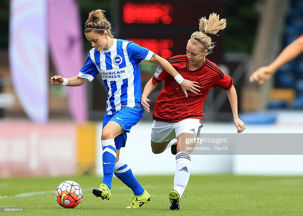 Kate Natkiel of Brighton holds off pressure from Stephanie Smith of Sporting Albion during the WPL Playoff match between Brighton & Hove Albion WFC and Sporting Club Albion LFC at Adams Park on May 29, 2016 in High Wycombe, England.