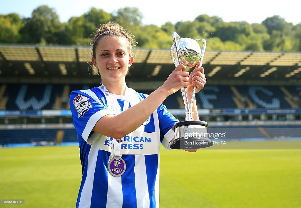 Kate Natkiel of Brighton poses with the trophy following her teams victory in the WPL Playoff match between Brighton & Hove Albion WFC and Sporting Club Albion LFC at Adams Park on May 29, 2016 in High Wycombe, England.