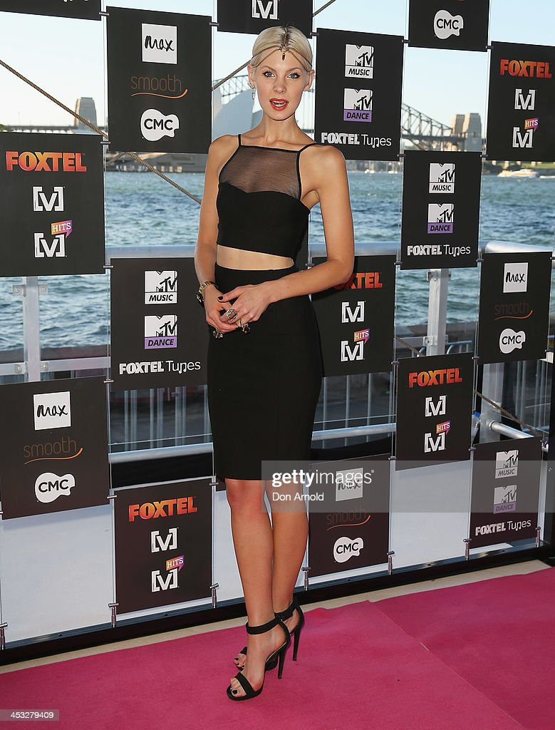 Kate Peck arrives at the Foxtel Music Channels Summer Launch at the Botanic Gardens on December 3, 2013 in Sydney, Australia.