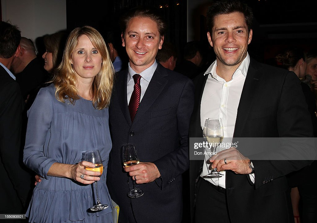 Kate Quirk, Aaron Quirk and Zac Farrah pose at the book launch of 'Nomad Two Worlds' by Russell James on November 1, 2012 in Sydney, Australia.