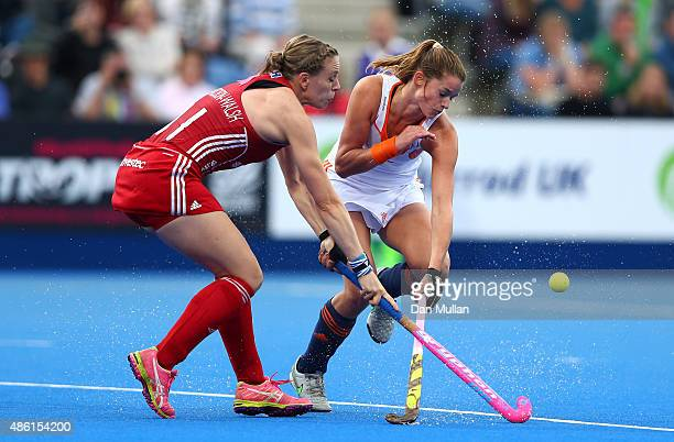 Kate RichardsonWalsh of England battles for the ball with Lidewij Welten of The Netherlands during the EuroHockey Womens Gold Medal match between...